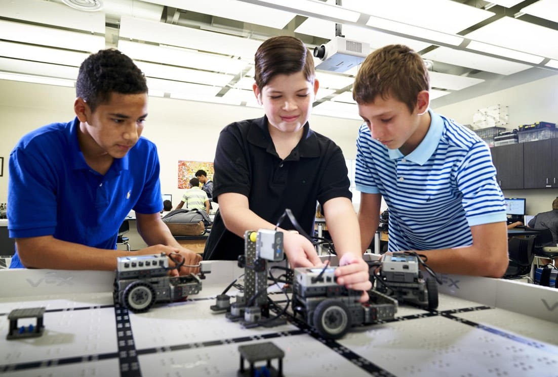 boys playing with STEM and robotics at Tampa Prep